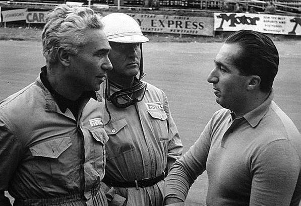 Ferrari drivers, Piero Taruffi (ITA), Giuseppe Farina (ITA) and Alberto Ascari (ITA) race winner. British Grand Prix , Silverstone, England, 19 July 1952.