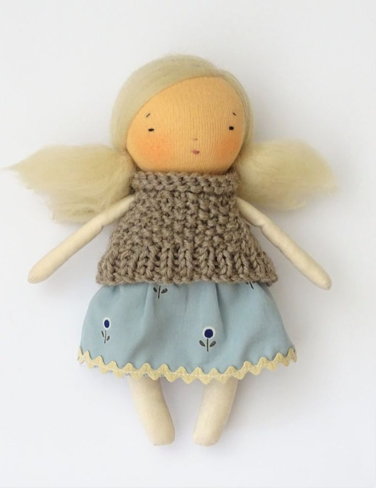 Image of Little blonde soft doll with knitted hat 7 inches tall