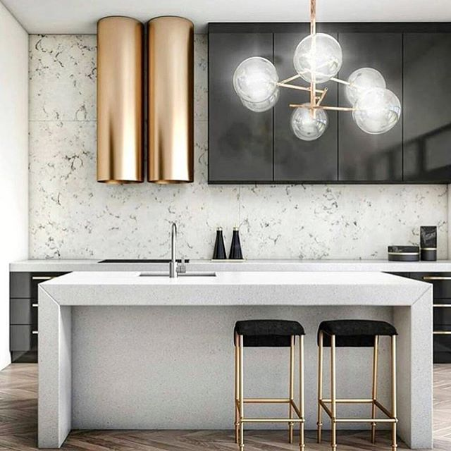 Modern Kitchen with beautiful brass accents.