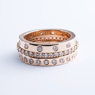 Create your perfect rose gold stack with various combinations of our stacking rings. Featured here is the 12 and 24 stone sandwiched by our custom eternity ring. All diamonds are high quality VS/F --