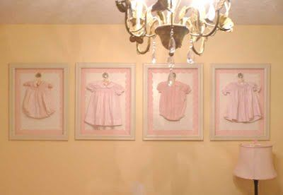 Baby clothes hung in frame on vintage door knob