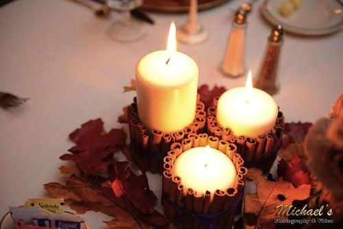 Cinnamon wrapped candle thanksgiving wedding centerpieces  | Real Green Wedding With A Thanksgiving Theme | Green Bride Guide