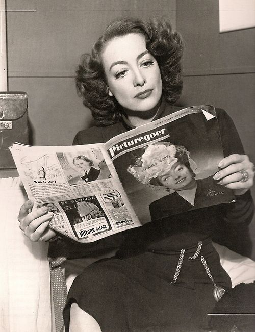 Joan Crawford Reading up on her favorite subject, Joan Crawford
