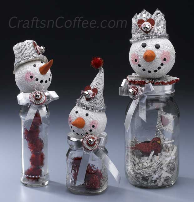 How to make vintage, mixed media snowmen for a Valentine's Day craft. Cute, snowman craft uses dictionary pages, ribbon, tinsel stems, buttons, etc. to create a vintage, mixed media theme. Recycled jars, too. #RecycleCrafts #SnowmanCrafts #ValentineCrafts