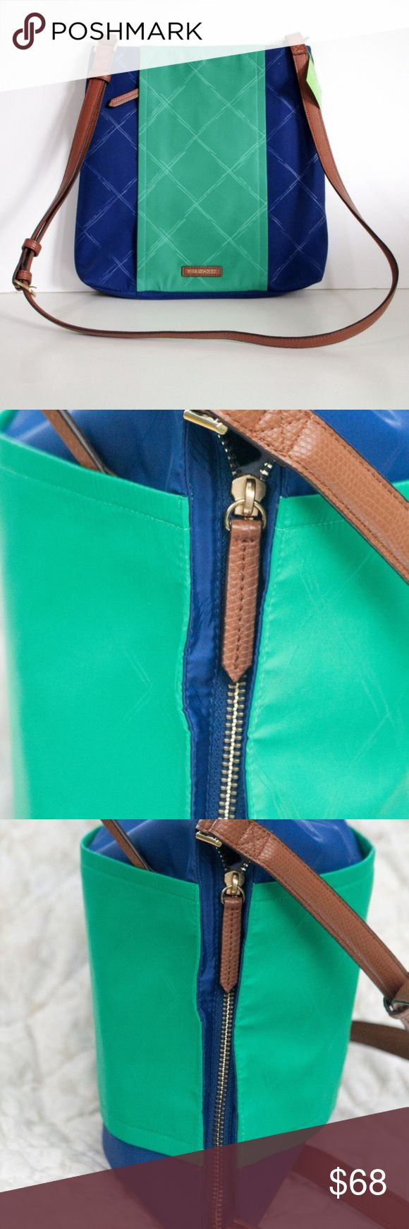"""Vera Bradley Preppy Blue and Green Crossbody Bag Vera Bradley  This small Preppy Poly Molly Crossbody bag has a color called Evening Sky and Clover. A deep blue and bright green make this sleek bag pop and stand out.   13"""" x 11"""" x 1.25"""" Weight: 12 oz  Top zip closure Adjustable crossbody strap with a drop length of 24 inches Vertical front zip pocket stores phone or keys A hidden magnetic slip pocket sits just inside the bag's recessed zip-top opening Interior has two slip pockets and a zip…"""