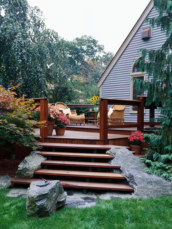 Instead of building around large rocks, these steps are built into them. More ways to work around landscape challenges: http://www.bhg.com