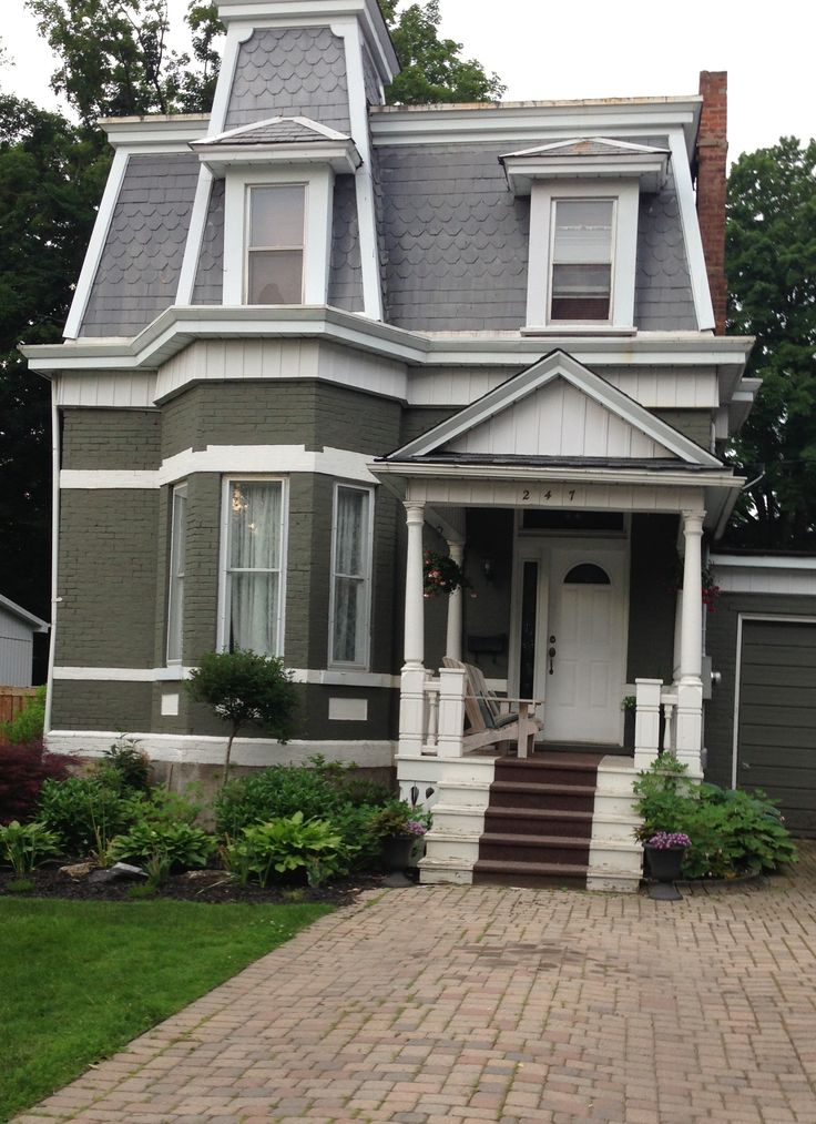 Putty-colored painted brick, slate, and great shapes make this one of my favorite older homes to look at.