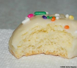 Italian Almond Cookies w/ Icing and Sprinkles Cookie ½ c butter soft ½ c sugar 3 Lrg eggs 2 tsp almond extract 2 ½ c flour 1 Tbsp baking powder 2-3 Tbsp milk ICING 2 c confectioner's sugar 3 Tbsp milk 1/2 tsp almond extract Sprinkles Preheat oven to 350 degrees Line cookie sheets non-stick liners  Bake 10-12 min
