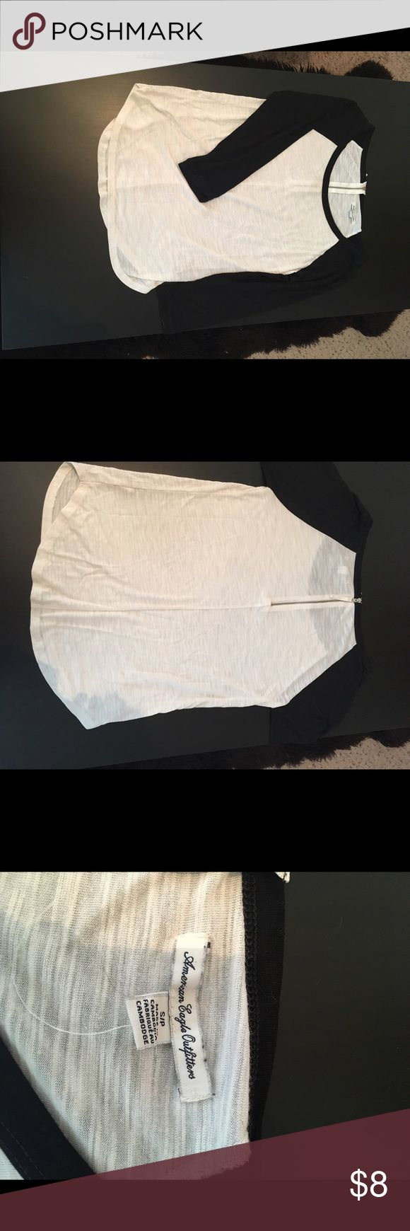 American eagle black and white baseball t shirt American eagle black and white baseball tee with zipper on back. Size small. Earliest I can ship is Saturday evening American Eagle Outfitters Tops Tees - Long Sleeve