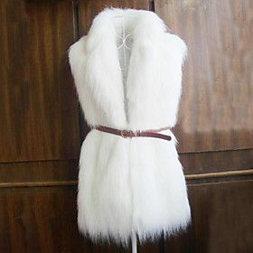 This white fur vest would look great with a grey sweater and black leggings unde…