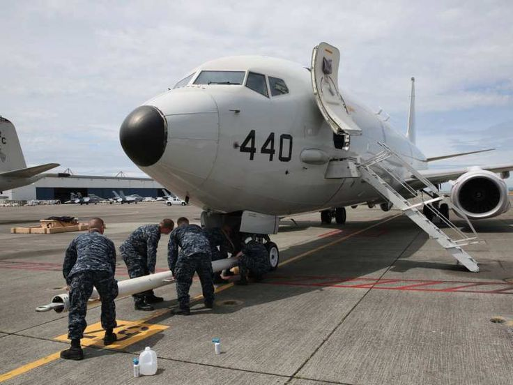 OAK HARBOR, Wash. (June 22, 2016) Sailors from Patrol Squadron (VP) 30 attach a tow bar to a P-8 Poseidon preparing to move it into Patrol and Reconnaissance Wing 10's newly renovated hangar six on Naval Air Station Whidbey Island's Ault Field for the first time. The P-8 is scheduled to replace the P-3, in naval service since the 1960s, no later than 2020. (U.S. Navy photo by Mass Communication Specialist 2nd Class John Hetherington/Released)