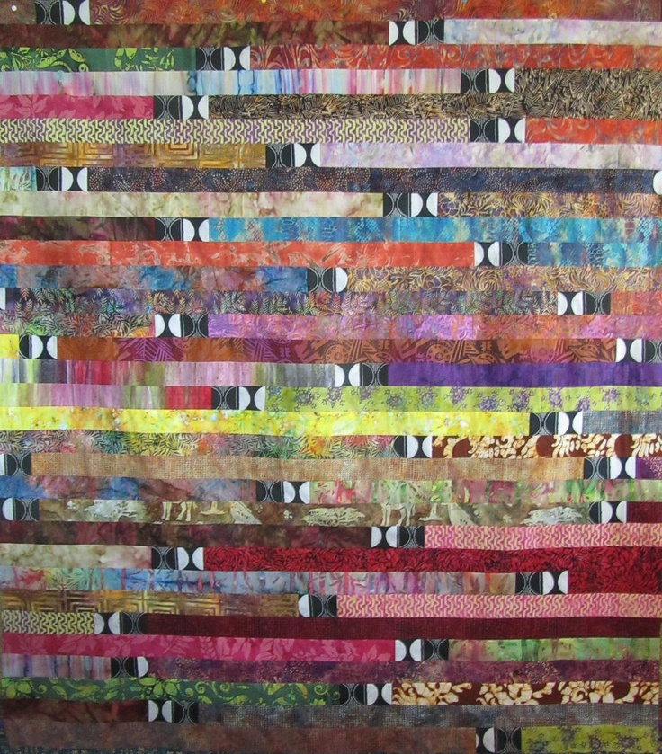 Quilts + Color: Sunrise - Sunset Quilt Tutorial Like the 1600 jelly roll quilt but it has little 'full stops' sewn in at each fabric change.