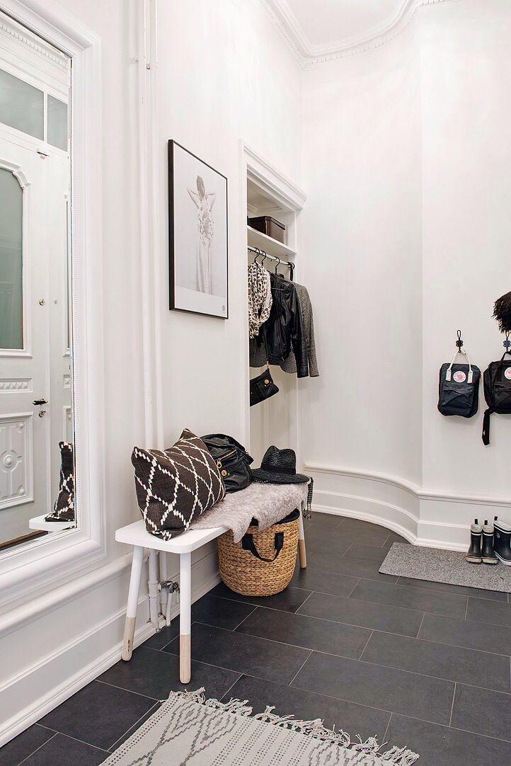 Practical tile in the hall with underfloor heating. Almost hidden closet with no door + bench + basket