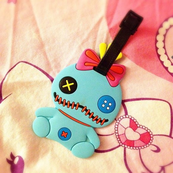 Stitch's Scrump Luggage Tag NWOT. Lovely Disney's Scrump from Stitch. Not an official Disney product. Super cute and must have for your luggage! I still have 3 pieces more, cannot find elsewhere in states. No lowest/trade/pp. Unknown Accessories
