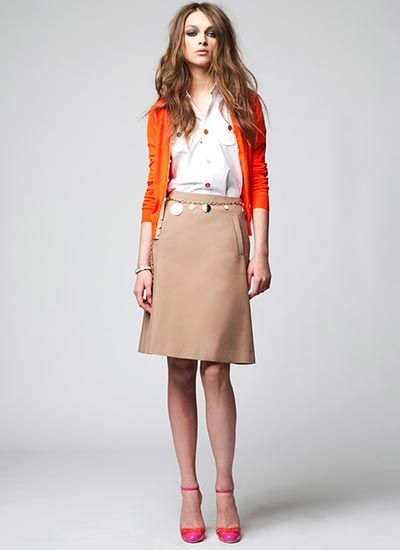 orange cardigan + camel skirt