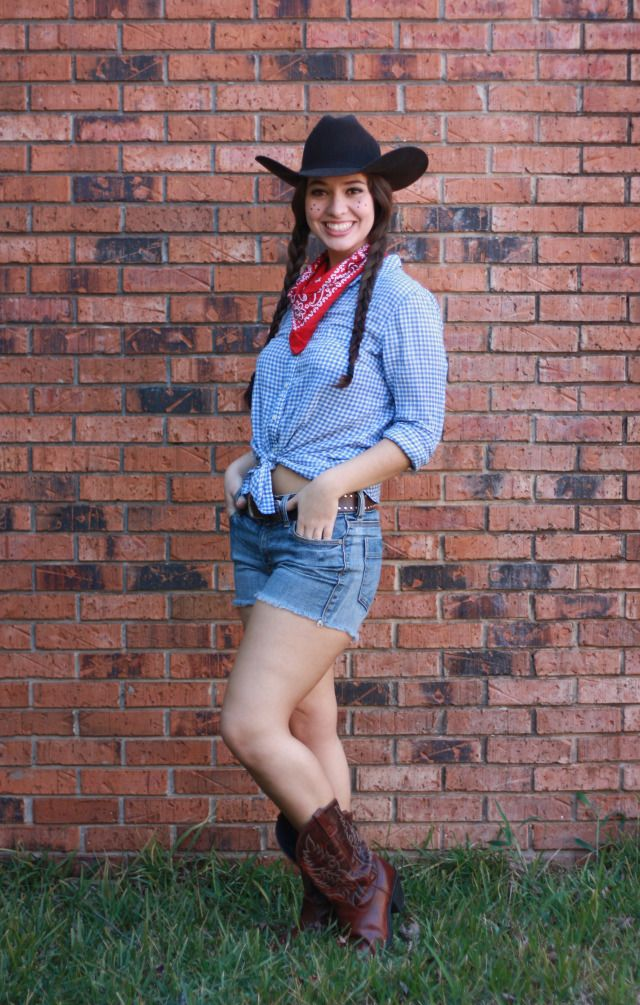 blue button down, white tank, jean shorts, boots, braided hair, red ribbons, bandanna, hat?