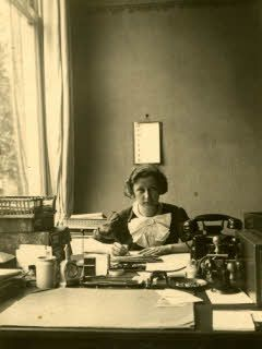 Miep Gies behind her desk at the Opekta office. She found Anne Franks diary and saved it for Otto Frank.