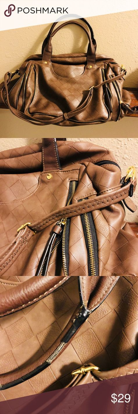 Big Buddha Carryall Bag This is the perfect carryon. It's definitely a larger bag. Faux leather with textured detail and black/gold around zippers. Adorable lining. Small imperfection on hand strap. This has a cross-body strap for easier transport. Lovely sandy brown in color. Big Buddha brand. Big Buddha Bags Travel Bags