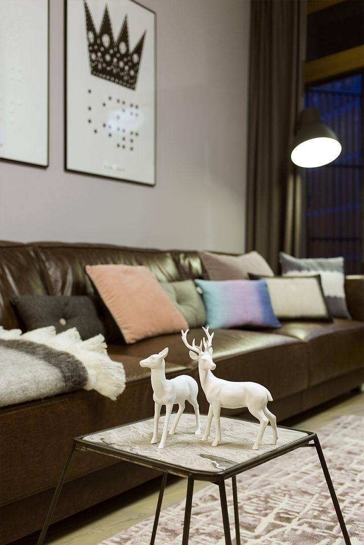 living room, vintage leather sofa, designers guild carpet, small coffee table, decorative colourful cushions, big loft floor lamp