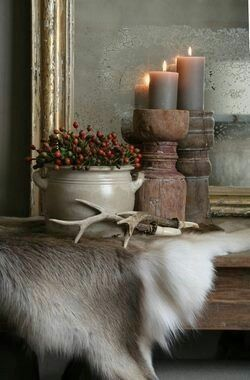 I like the hide and candlesticks on the mantle
