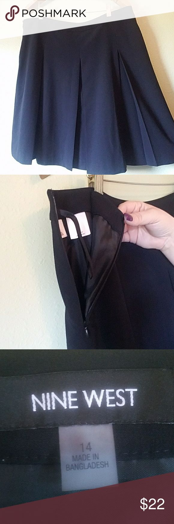 Nine West Skirt Beautiful pleated skirt by Nine West in size 14. The skirt length is 24 inches from waist to hem with full lining inside and a zipper on the side. The skirt has beautiful pleating and would go perfect paired with a colorful Blazer and colorful heels. In amazing condition! Nine West Skirts Circle & Skater