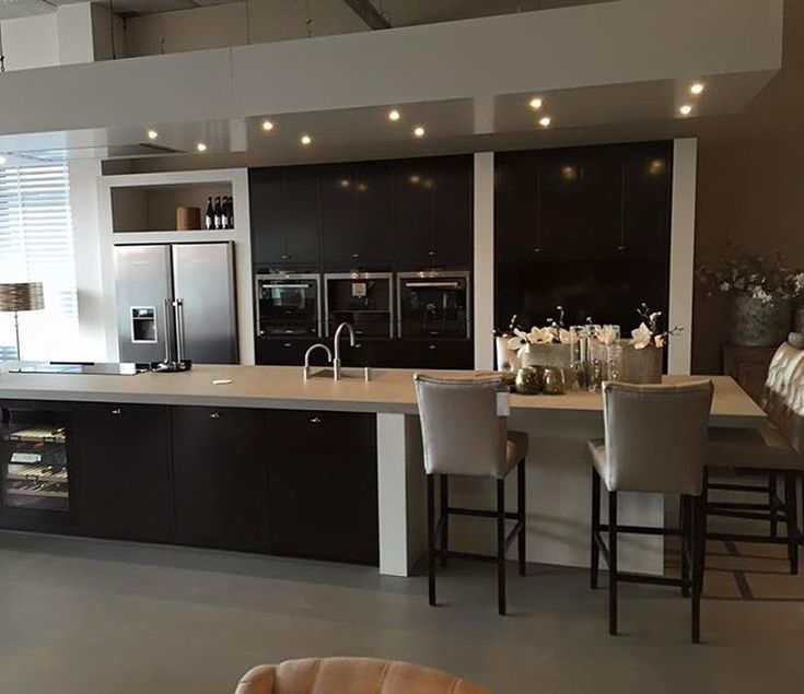 Contemporary Kitchen With Long Island With Dining Area