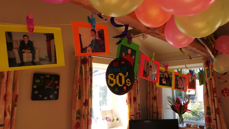 It wouldn't be a 30th birthday party without embarrassing baby photos! Back a selection of your favourite pics onto fluorescent card, drape some string or ribbon across the room and peg up your photos - I found fluorescent coloured washing pegs in Tesco that worked a treat! Find more 80's top tips here... http://thatideasgirl.com/birthdays/idea-5-80s-themed-30th-party/