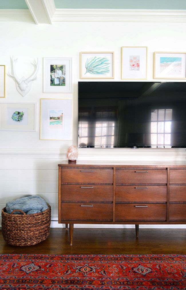 A TV gallery wall is a great solution for around your television, helping prettify that big black box with a mix of framed art and objects.