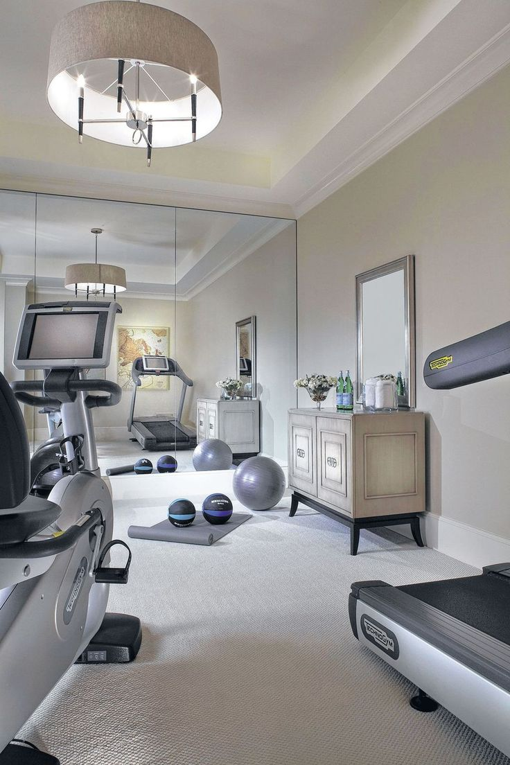 """Clean, elegant, white home gym. Love the dresser, makes it feel more like a real """"home"""" gym"""