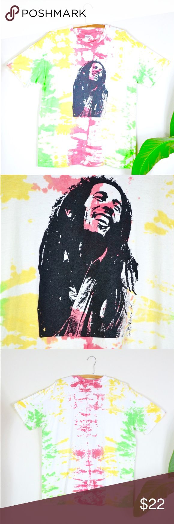 "1990s Bob Marley t shirt 🍁 rasta VTG unisex tee Ya mon! 1990s screen printed Bob Marley tie dye t-shirt with muted rasta colors. adult unisex fit, small stain on one shoulder, otherwise great vintage condition!  FEATURES: label - tedman hi-cru size listed - XL (46/48) made of - 100% cotton made in USA  *vintage sizes vary from todays, so be sure to check measurements to ensure a good fit*  MEASUREMENTS: laying flat, double when appropriate 28.5"" length 23.5"" bust 21"" shoulder to shoulder…"