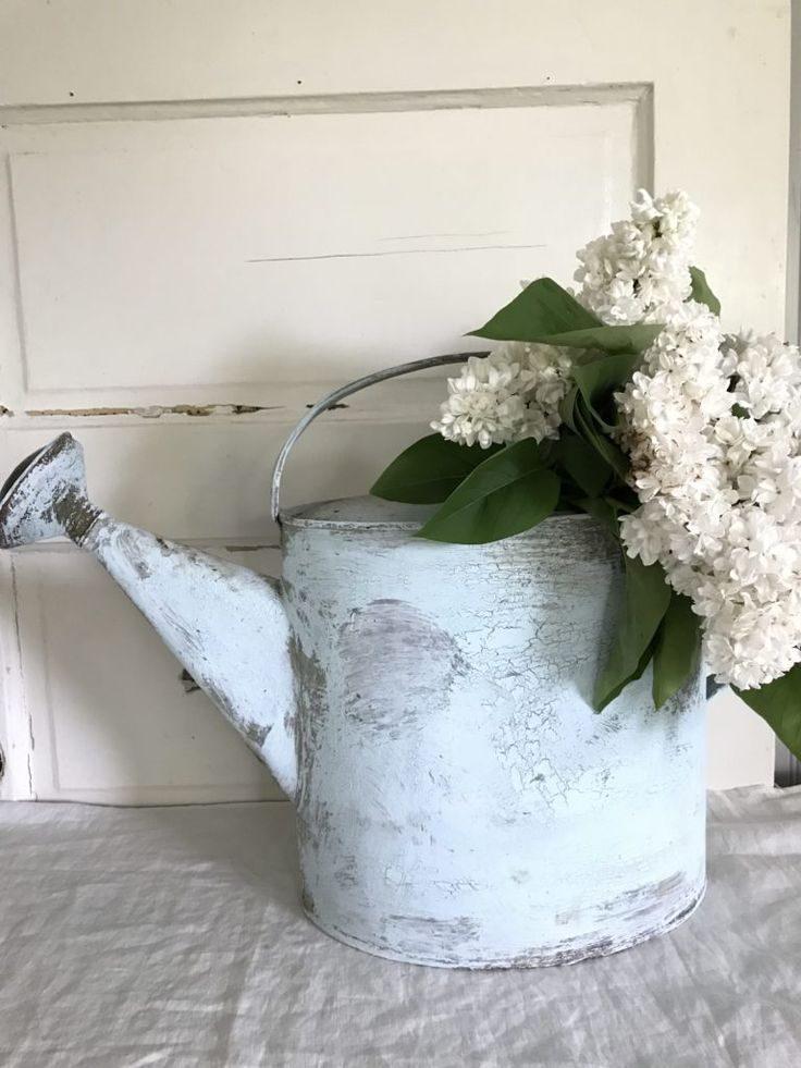 "If you love farmhouse décor you will love this DIY ""Chippy Paint"" Farmhouse Watering Can project from Rhonda at Hollstrom Home"