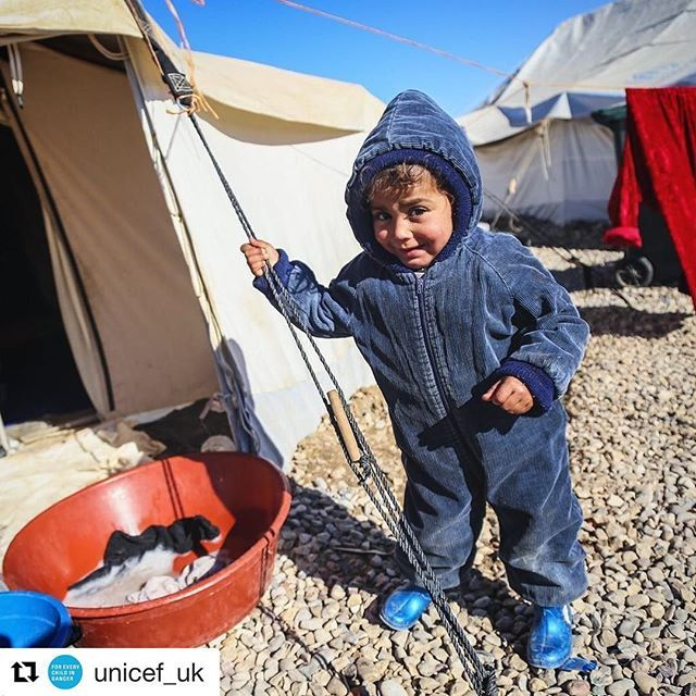 #Repost @unicef_uk with @repostapp ・・・ Two-year-old Rwan from Mosul looks very cosy in his winter clothing. He is from Mosul but like thousands of others has been forced to flee his home because of the ongoing conflict and now lives in a camp in Iraq. We are providing children and families with essential winter supplies to help them combat the freezing temperatures. Photo: Unicef 2016 Khuzaie #iraq #cosy #winter #winterclothes #smile #photooftheday #nofiltermcgregor_ewan