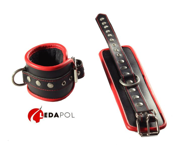 Pair of trimmed wrist shackles.