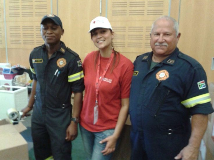 Lauren from Stor-Age Table View feeling proud next to the Cape Town Fire Department at the CTICC.