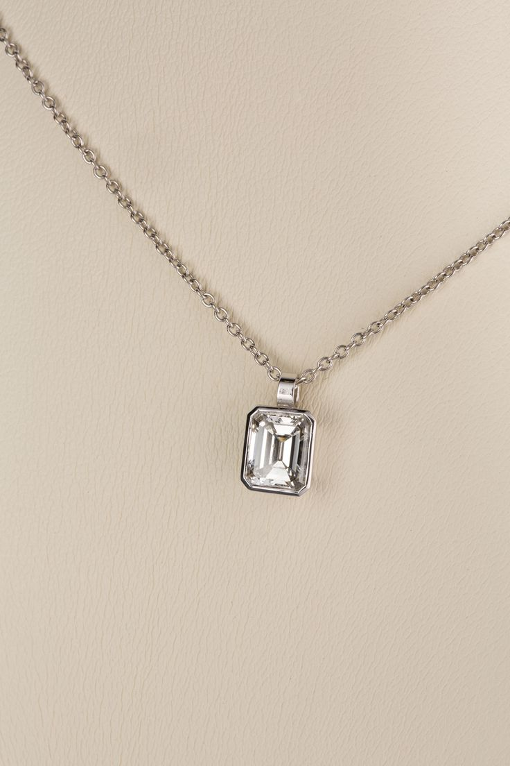 Emerald Cut Diamond Drop pendant weighs approximately 1.25cts, H/I Colour, VS1 clarity, sits tastefully in an 18ct white gold bezel mount with an attached flat pendant bale. A handmade piece that would be suitable for everyday wear and adds a classic look to your ensemble.