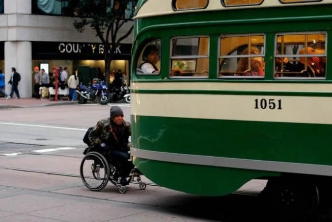 Wheelchair Skitchin In This Picture: Photo of person on wheelchair behind bus