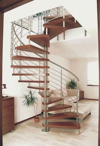 spiral wood stairs with stainless steel railings