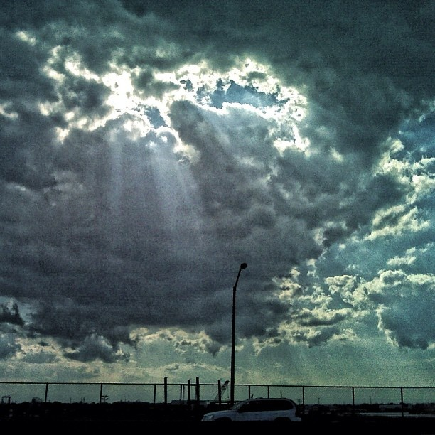 """@emslowatson's photo: """"beams of light coming through the clouds on a long drive home~"""""""