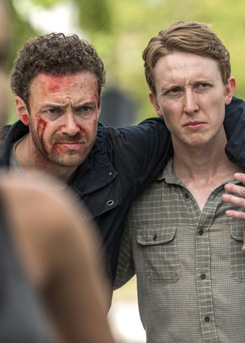 """Aaron (Ross Marquand) and Eric (Jordan Woods-Robinson) 