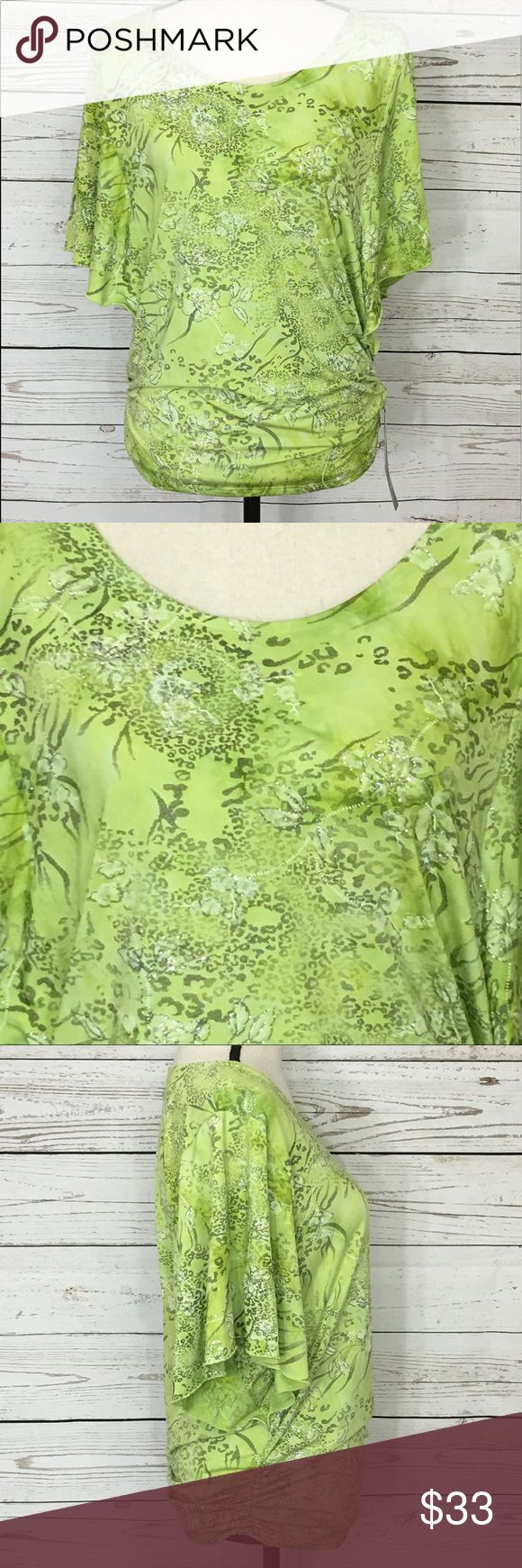 "JM Collection Batwing Angel Sleeve Glitter Blouse Beautiful green with silver glitter blouse with batwing, angel sleeves. The sides of the blouse are ruched. New with tags.  Bust: (M-40""); Length in the back from the shoulder:  (M-25""). Measurements are approximate. Smoke free home. 🌺Thanks for shopping my closet !🌹 JM Collection Tops Blouses"