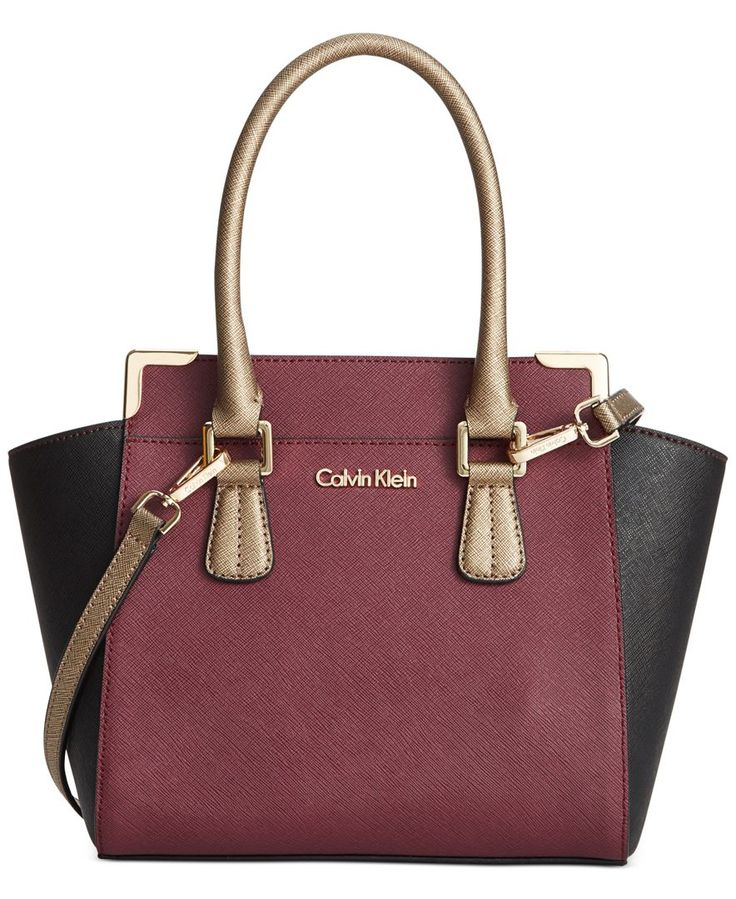 Crisp colorblocking adds a modern element to this classic crossbody bag Calvin Klein. Fashioned in luxe Saffiano leather with signature detailing, slender rolled handles offer a refined finish.   Calv