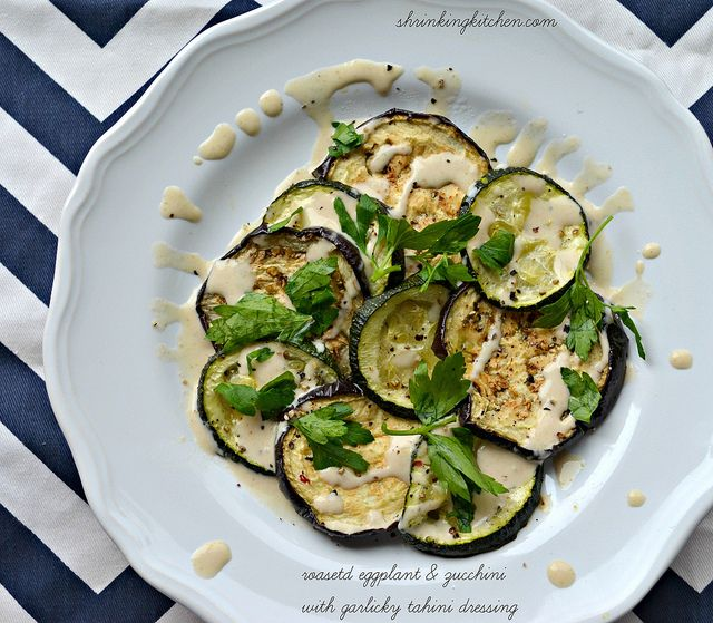 Roasted Eggplant & Zucchini with Garlicky Tahini Dressing is a warm, flavorful & satisfying side dish.  Serve it as a main or  a hearty side! from shrinkingkitchen.com #healthy #eggplant #recipe