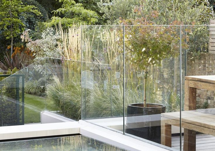 Glazed balustrade allows views to the garden from the new terrace on the roof of our period extension.