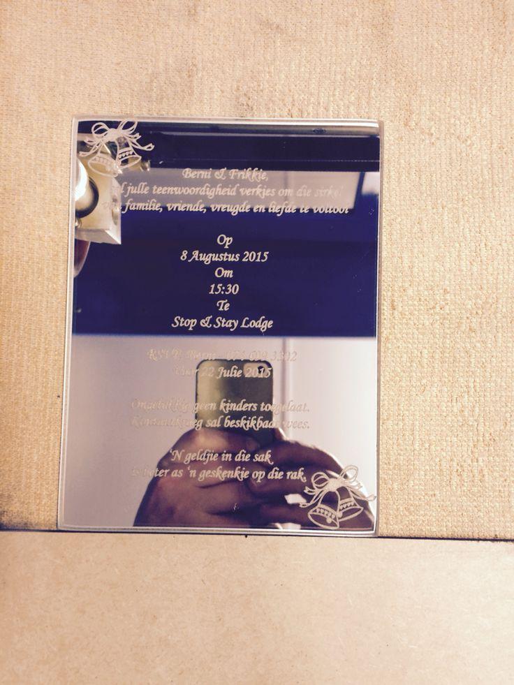 Laser engraved wedding invite on mirror