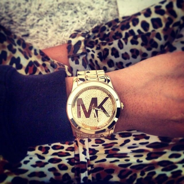 I've ALWAYS wanted a michael kors watch. i love the brand. I have a few things - purse, rings, phone case, and shoes.