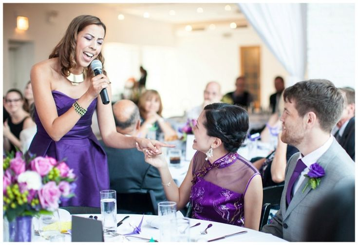 The bride selects her maid of honor to support before and during the wedding ceremony.
