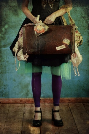 i should very much like to travel the world in a turquoise tutu carrying only an overstuffed, overused, and overloved leather bag.