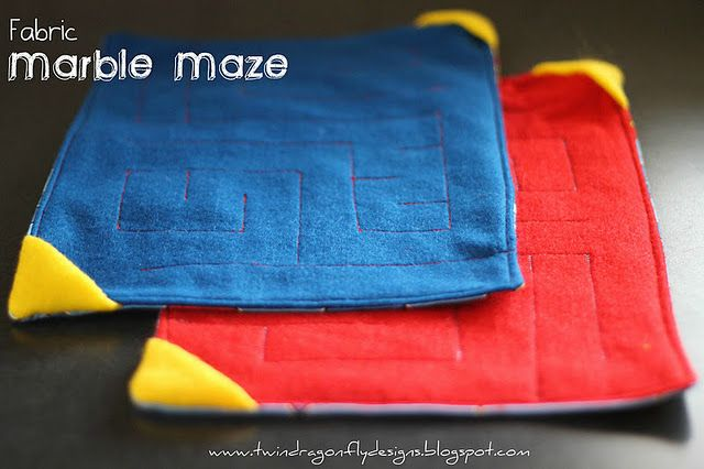 neat fabric marble maze ... the marble is inside - To Do as a quiet book page! Made these