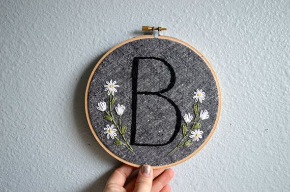 MADE TO ORDER: Please allow 3-4 weeks for your embroidery hoop to be recreated.  This sweet initial hoop is a perfect gift for just about any occasion! It makes a lovely nursery decoration, housewarming gift, or give one to the newly engaged or married couple! Its also perfect for your own home!  The colors are totally customizable, and you can even request specific flowers if youd like.  Details: - 6, 8, or 10 inch hoop (other sizes available by request)  Info you will need to give me when…