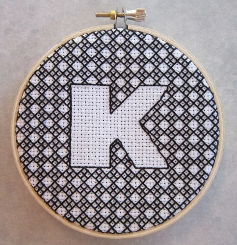 A blackwork K ... This is a cool way to do negative space for any letter or simple shape.